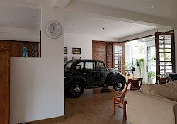 The King's villa living room and car