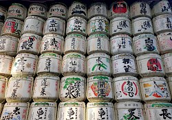 Dozens of barrels of sake on a wall